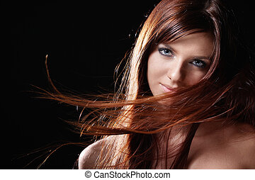 Styling - Developing hair beautiful girl on black background