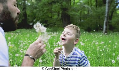 Young father with little boy, sunny spring day. - Young...
