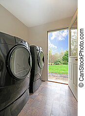 Laundry room - Washer and dryer in a private residence in...