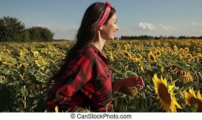 Happy summer girl laughing in sunflower field - Profile of...