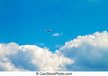 passenger airplane high in the sky in the clouds - Image...