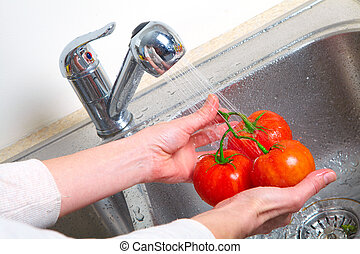 Tomato in the sink. Fresh red tomato