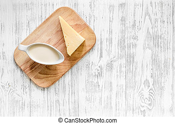 Natural food. Milka and cheese on light wooden background...