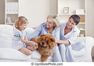 Happy Family - Young family with a dog at home
