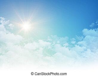 Rising sun in a cloudy blue sky
