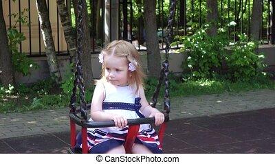 Little girl straightens her hair
