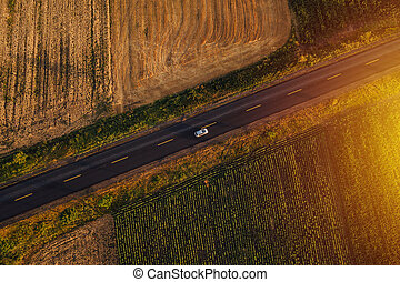 Aerial view of cars on the road in sunset - Aerial view of...