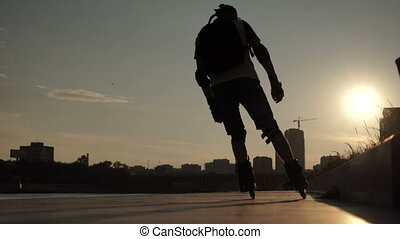 Silhouettes of people walking down the street of the city