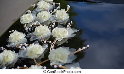 Black car decorated with white roses
