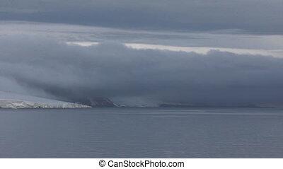 huge dark cloud slides from glacier. - Harsh Arctic. Huge...