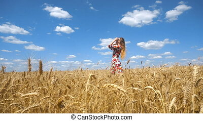 beautiful girl standing in a wheat field and straightens your hair