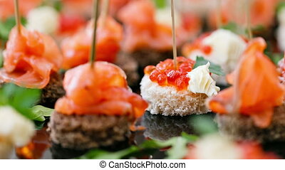 the buffet at the reception. Assortment of canapes. Banquet...