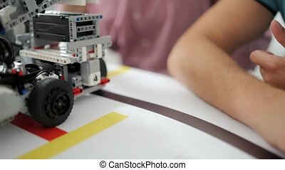 Scaled up shot of self driving robotic devices - Examining...