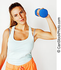 young pretty slim blond woman with dumbbell isolated...