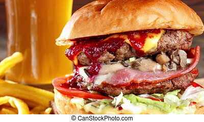 Close-up of home made tasty burgers with beef, mushrooms,...