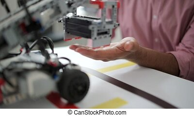 Man testing robotic possibilities - Testing the quality of...