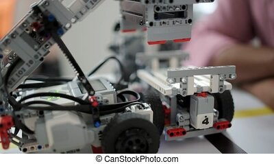 Scaled up look on robotic devices working - Checking new...