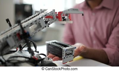 Robotic machine testing process - Looking at the machine in...