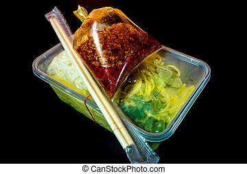 Spaghetti with sauce Take home food in plastic packaging -...