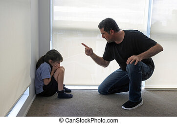 Angry father telling off his daughter - Angry father (age...