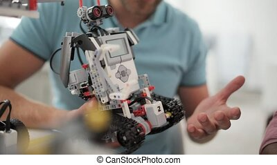 Close up of robot in male hands - This robot can do merely...