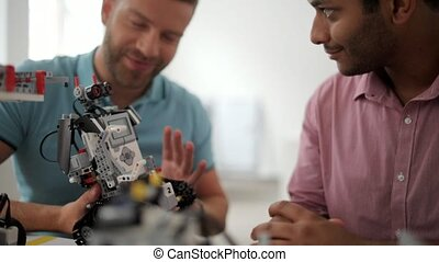 Positive men talking over robot - We have done a pretty good...