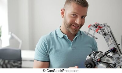 Smiling man showing his robotic machine into camera - Me and...