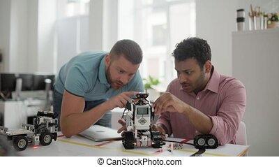 Focused millennial engineers at work