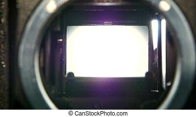 Closeup camera lens. Camera shutter aperture transition in...
