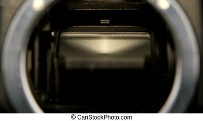 Diaphragm camera shutter blade in slow motion. Closeup...