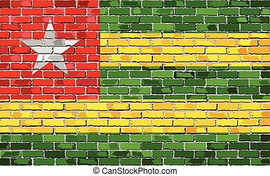 Flag of Togo on a brick wall