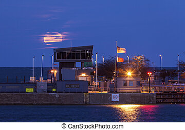 Full moon rising by Lake Michigan in Chicago
