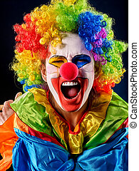 Mad clown on black background. Portrait of crazy woman. -...