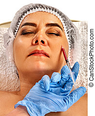 Filler injection female face. Plastic facial surgery in beauty clinic.