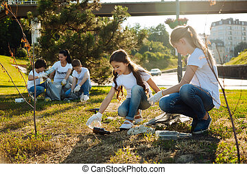 Warm-hearted friends gathering glass rubbish - Cast out all...