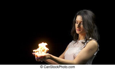 Beautiful girl and burning soap bubbles