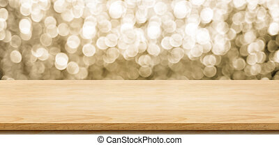 Empty wood table top with blur sparkling gold bokeh abstract...