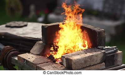 Blacksmith fire with hot metal. Heating of the metal in the furnace.
