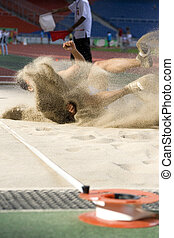 Long Jump - Image of a long jumper in action with a...