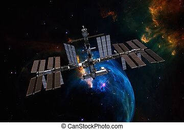 International Space Station over nebula. Elements of this...