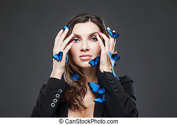 Beauty Fashion Model Girl with a large number of butterflies...