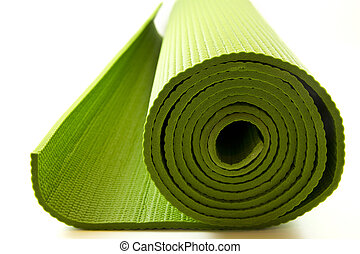 yoga mattress - A rolled up green yoga or pilates mattress...