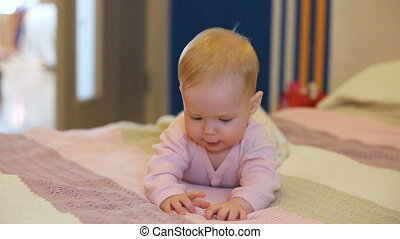 Baby on a bed in the bedroom.Newborn child relaxing in...