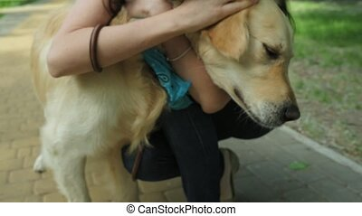 Loving woman embracing her purebred dog