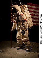 Astronaut - An astronaut standing in front of an American...