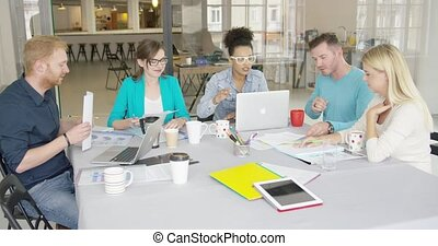 Group of people collaborating in office - Group of young...