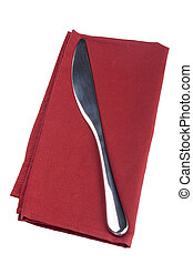 Table knife on a red cloth, tissue.