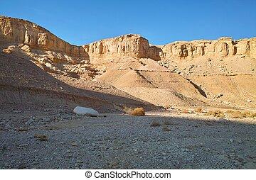 Sandstone rocks in the desert at sunset