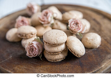 Beige macarons and dry roses vintage background