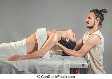 Massage stretching therapy. A young professional male...